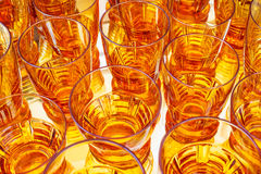 Vintage orange alcohol glasses Stock Photos