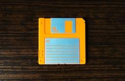 Vintage orange floppy disc background Stock Photos