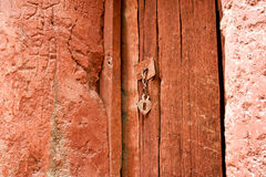 Vintage orange painted wooden door Royalty Free Stock Photography