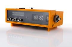 Vintage orange radio clock Royalty Free Stock Photo