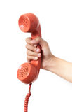 Vintage orange telephone handset over white background.  Royalty Free Stock Photography