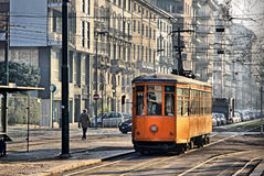 Vintage orange tram in Milan, Italy