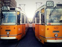 Vintage orange trams on the street of Budapest Royalty Free Stock Photo