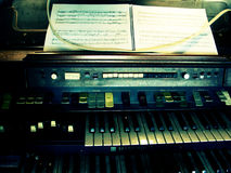 Vintage Organ. An extremely old, vintage organ with sheet music resting on top of it. This organ is truly one of a kind royalty free stock photography