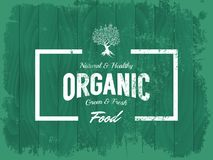 Vintage organic, natural and healthy food vector logo isolated on wood board background. Stock Photography