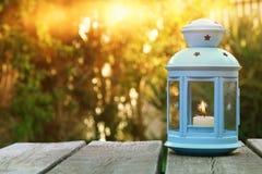 Vintage oriental lantern over wooden table outdoors Stock Photos