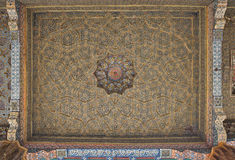 Vintage oriental patterns decorate the ceiling. Vintage oriental patterns decorate the ceiling in Bukhara Stock Photo