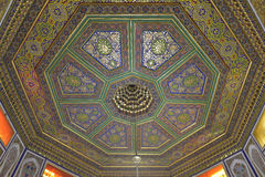 Vintage oriental patterns decorate the ceiling. Vintage oriental patterns decorate the ceiling in Bukhara Stock Photography