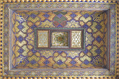 Vintage oriental patterns decorate the ceiling. Vintage oriental patterns decorate the ceiling in Bukhara Stock Images