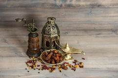 Vintage orintal latern and mill. Raisins and dates Stock Images