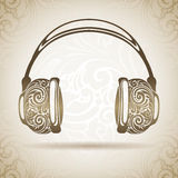 Vintage ornamental headphones. Royalty Free Stock Photography