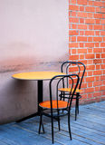 Vintage Outdoor caffe. Small table and two retro chairs on the terrace in old town bistro Royalty Free Stock Photo