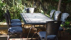 Vintage outdoor dining table with 8 stock images