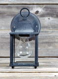 Vintage Outdoor Light on Weathered Wood Royalty Free Stock Image
