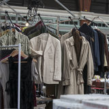 Vintage outerwear, coats hanging on a rack. Spitalfields Antic Market. vintage outerwear, coats hanging on a rack stock image