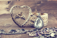 Vintage oval pendant with shiny stone and jewelry Stock Photography