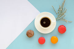 Vintage overhead composition of blank note with macarons and coffee mug Stock Photos