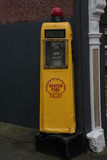 Vintage Oyster fuel pump. A vintage yellow Oyster fuel pump, Carlingford, Ireland stock photography