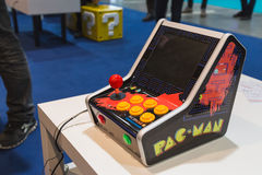 Vintage Pac Man console at Games Week 2014 in Milan, Italy. MILAN, ITALY - OCTOBER 24: Vintage Pac Man console at Games Week 2014, event dedicated to video games royalty free stock photo