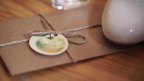 Vintage package tied up with string. Close up envelope sealed. Envelope of kraft paper tied with twine, with a red wax. Seal, close up HD stock video footage