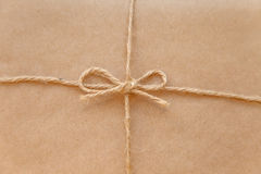 Vintage package tied up with string macro. Close up Royalty Free Stock Photos