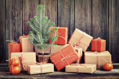 Vintage packages and young Christmas tree. Against the background of the old wooden boards Royalty Free Stock Photography