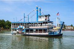 Vintage paddlwheel steamboat painted in old-fashioned American in the river royalty free stock photos