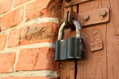 Vintage padlock. Close-up (closed door Royalty Free Stock Photography