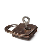 Vintage padlock with key on white background. Retro style private security object. Stock Photos