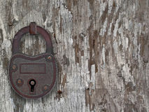 Vintage padlock on a old door Stock Image