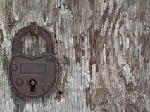 Vintage padlock on a old door Stock Image