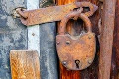 Vintage padlock on wooden door Royalty Free Stock Image