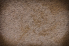 Vintage painted plaster concrete wall. Dark edged Royalty Free Stock Images