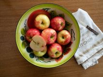 Vintage Painted Tin Bowl with Apples with Dish Towel and Paring stock photo