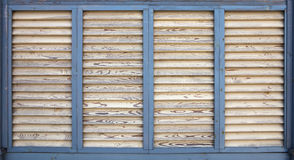 Vintage painted wooden blinds. Outdoors Stock Images
