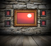 Vintage painting frames like windows on wall. And beautiful sunrise seen through ( the background in also a photo I made Stock Photo
