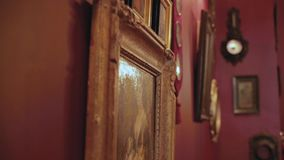 Vintage paintings on the wall in retro frame.  stock footage