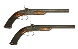 Vintage pair of pistols. Pistols possibly dueling isolated on white Stock Photos