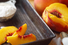Vintage pan with fresh peach slices Stock Images