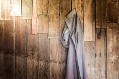 Vintage,Pants hanging on the wooden wall Stock Image
