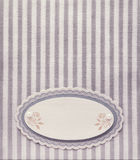 Vintage paper blank label on retro style striped pattern background. Retro purple textile album page layout. Vintage paper blank label on retro style striped Royalty Free Stock Photos