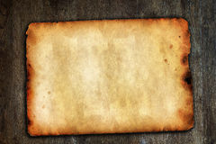 Vintage paper on brown wooden surface. Old vintage paper on brown wooden surface with natural texture Stock Image