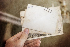 Vintage paper card in hand Royalty Free Stock Photos