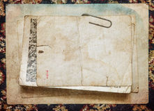 Vintage paper card on old cloth background Royalty Free Stock Photos