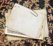 Vintage paper card on old cloth background Royalty Free Stock Images