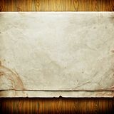 Vintage paper card on wooden texture Royalty Free Stock Image