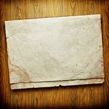 Vintage paper card on wooden texture Stock Photography