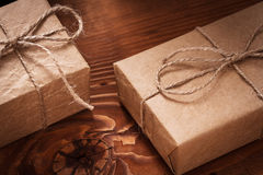 Vintage paper giftboxes on old wooden boards Stock Photos