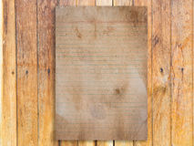 Vintage paper on grunge wood Royalty Free Stock Images
