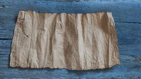 Old paper on the wood background. Vintage paper on grunge wooden background royalty free stock image